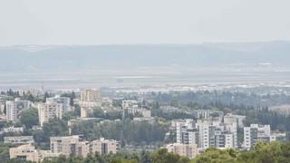 מגדל העמק על רקע עמק יזרעאל