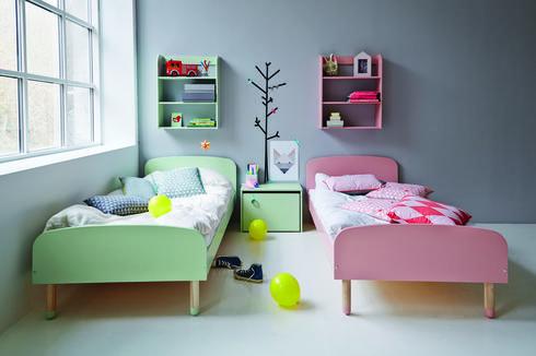 בחירה של מיטות זהות ומיקומן בצורה מקבילה בשתי פינות החדר, יוצרת חלל מעוצב. טולמנ'ס דוט, בית יהושע